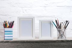Close up view of photo frames and office supplies. At workplace stock image