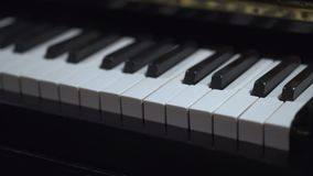 Close up view of piano keys. Piano keyboard background with selective focus. Close frontal view. Camera moves left. Image slowly blurring stock video footage