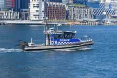 Close-up view of a police boat patrolling in Sydney, Australia. Sydney, Australia - May 11, 2017: Close-up view of a police boat patrolling in Sydney, Australia stock images