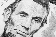 Close up view Portrait of Abraham Lincoln on the one five dollar bill. Background of the money. 5 dollar bill with Abraham Lincoln. Eyes macro shot. Money stock photos