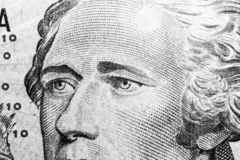 Close up view Portrait of Alexander Hamilton on the one ten dollar bill. Background of the money. 10 dollar bill with Alexander Ha. Milton eyes macro shot. Money stock images