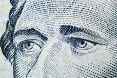 Close up view Portrait of Alexander Hamilton on the one ten dollar bill. Background of the money. 10 dollar bill with Alexander Ha. Milton eyes macro shot. Money royalty free stock photos