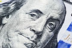 Close up view Portrait of Benjamin Franklin on the one hundred dollar bill. Background of the money. 100 dollar bill with Benjamin. Franklin eyes macro shot stock photo