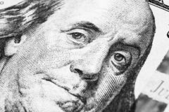 Close up view Portrait of Benjamin Franklin on the one hundred dollar bill. Background of the money. 100 dollar bill with Benjamin. Franklin eyes macro shot royalty free stock photography