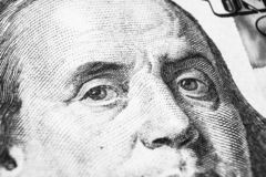 Close up view Portrait of Benjamin Franklin on the one hundred dollar bill. Background of the money. 100 dollar bill with Benjamin. Franklin eyes macro shot stock image