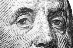 Close up view Portrait of Benjamin Franklin on the one hundred dollar bill. Background of the money. 100 dollar bill with Benjamin. Franklin eyes macro shot stock images