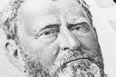 Close up view Portrait of Ulysses S. Grant on the one fifty dollar bill. Background of the money. 50 dollar bill with Ulysses S. G. Rant eyes macro shot. Money stock image