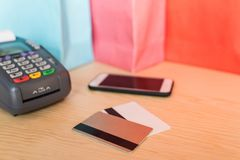 close-up view of POS terminal with credit cards royalty free stock photos