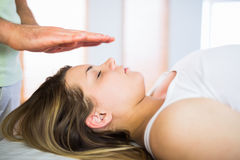 Close up view of pregnant woman getting reiki treatment Royalty Free Stock Photos