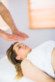 Close up view of pregnant woman getting reiki treatment Royalty Free Stock Photography