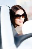 Close-up view of pretty female driver. Close up of pretty female driver in the white auto Stock Photos