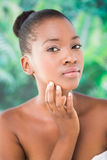 Close up view of a pretty girl touching her chin Stock Photography