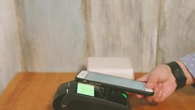 Close up view process of contactless payment. Seller put the payment terminal stock footage