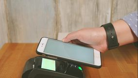 Close up view process of contactless payment. Seller put the payment terminal stock video footage