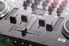 Close up view of a professional DJ console. 4 channel Dj console view with blurred knobs in the background Stock Photography