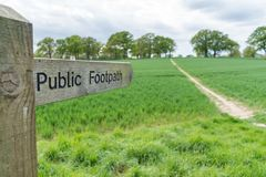 Close up view of a public footpath sign in Surrey, UK royalty free stock photos