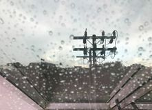 Close up view of rain drop on office or house window with elect royalty free stock photo