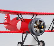 Close up view of red biplane flying in the sky. Stock Photos