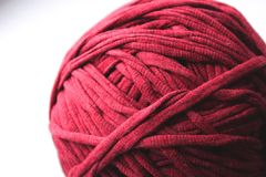 Close up view of red clew thread for knitting. On white background royalty free stock photography