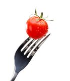 Close up view of red tomato on the fork Stock Photo