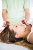 Close up view of relaxed pregnant woman getting reiki treatment Stock Image