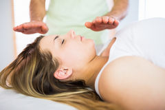 Close up view of relaxed pregnant woman getting reiki treatment Royalty Free Stock Photos