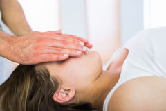 Close up view of relaxed pregnant woman getting reiki treatment Royalty Free Stock Image