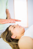 Close up view of relaxed pregnant woman getting reiki treatment Royalty Free Stock Photography