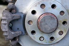 Close up view of replaced new brake pads and rotor Royalty Free Stock Photo