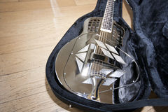 Close-up view of resonator guitar in carry case Stock Photos