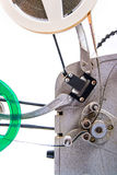 Close up view of retro motion picture film projector  on. Vintage old reel movie projector for cinema. Close up view of analogue movie projector with reels Royalty Free Stock Photos