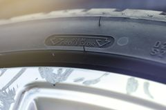 Rim protection feature at the sidewall of a high perfomance car tire mounted on a scraped aluminum rim. Close up view on the rim protection feature at the royalty free stock photos