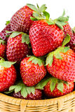 Close-up view of ripe strawberries in a wicker basket isolated o Stock Photography