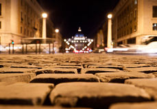 Close up view on the road pavement bricks at night in Rome, Ital Stock Image