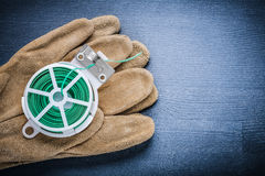 Close up view rolled garden wire and glove Stock Image