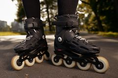 Close up view of roller skates on female feet Stock Photo