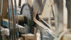 Close up view of rotated chain gear - part of industrial machinery - manufacturing. Macro shot stock video
