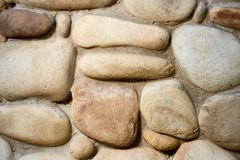 Close-up view of rough weathered stone wall texture full frame background royalty free stock photos