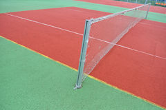 Close up view of a rubber broken tennis net. Untidy land Royalty Free Stock Images