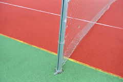 Close up view of a rubber broken tennis net. Untidy land Stock Images