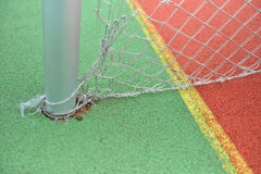 Close up view of a rubber broken tennis net. Untidy land Stock Photography