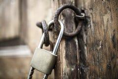 Locked old wooden door stock photo