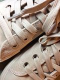Detail of trainers and laces. Close-up view of salmon colored trainers and laces royalty free stock images