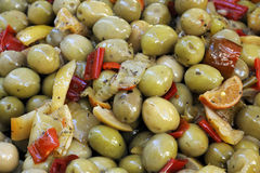 Close up view of seasoned green olives Stock Photos