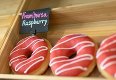 Fruity raspberry doughnuts for sale stock photos