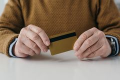 Close-up view of senior man. Holding credit card Stock Photos