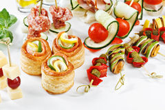 Close-up view set of canapes with vegetables, salami, seafood, m Stock Photography