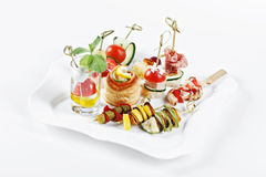 Close-up view set of canapes with vegetables, salami, seafood, m Stock Photo