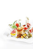 Close-up view set of canapes with vegetables, salami, seafood, m Royalty Free Stock Photos