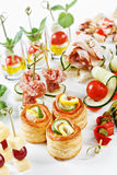 Close-up view set of canapes with vegetables, salami, seafood, m Royalty Free Stock Images